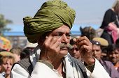 Old man shows his moustache at moustache competition,Pushkar,Rajasthan,India