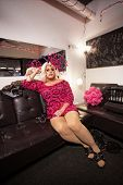 picture of cross-dressing  - Man in dress and wig sitting in a dressing room - JPG