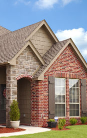 picture of entryway  - Home entryway with sidewalk leading to stone archway - JPG
