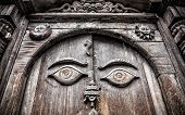 stock photo of nepali  - Wooden door with eyes at king palace museum on Durbar square in Kathmandu Nepal - JPG