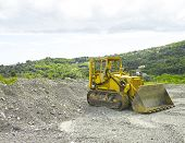 image of heavy equipment operator  - digger Heavy Duty construction equipment parked at work site - JPG