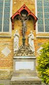 foto of grieving  - Crucifixion with two grieving figures adorning the cathedral in Bruges - JPG