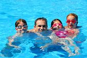 image of swimming pool family  - Happy family in a swimming pool - JPG