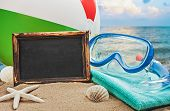 foto of blue things  - blackboard and things for the beach against the blue sea - JPG