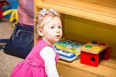 stock photo of montessori school  - Little child girl playing in kindergarten in Montessori preschool Class - JPG