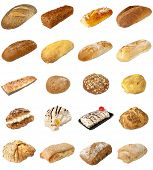 stock photo of bap  - A selection of freshly baked bread baps and cakes isolated on a white background - JPG