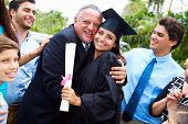 stock photo of extended family  - Hispanic Student And Family Celebrating Graduation - JPG