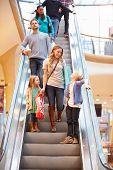 foto of escalator  - Mother And Children On Escalator In Shopping Mall - JPG