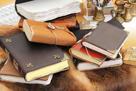 stock photo of annal  - Old book and inkstand on the fur leather - JPG