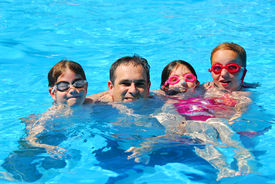 stock photo of swimming pool family  - Happy family in a swimming pool - JPG