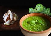 picture of pesto sauce  - Bowl of pesto alla genovese Italian recipe for an exquisite noodles sauce garlic and basil two of the main ingredients along with olive oil parmesan cheese and pine nuts - JPG