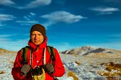 picture of saddening  - climber reaches the top in the Carpathian mountains