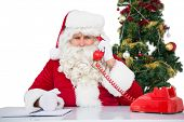 picture of irritated  - Irritated santa claus on the phone on white background - JPG