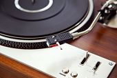 picture of analogy  - Stereo Turntable Vinyl Record Player Analog Retro Vintage Closeup - JPG