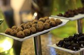 picture of cake-ball  - Brown ball cakes canape on a tray at the buffet - JPG