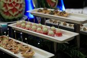 pic of buffet lunch  - Cakes canape on a plate at the buffet - JPG