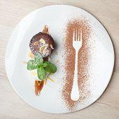 stock photo of cake-ball  - Warm dessert chocolate cake Fondant served on plate with ice - JPG