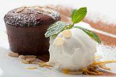 image of cake-ball  - Warm dessert chocolate cake Fondant served on plate with ice - JPG