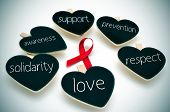 foto of respect  - a red ribbon for the fight against AIDS and some heart - JPG