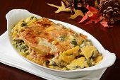 stock photo of butternut  - Gourmed butternut squash and spinach gratin in a small casserole dish - JPG