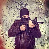 stock photo of terrorist  - terrorist portrait and background explosion - JPG