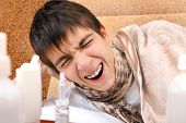 stock photo of home remedy  - Sick and Sleepy Teenager Yawning on the Sofa at the Home - JPG