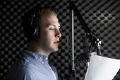 foto of recording studio  - Man In Recording Studio Talking Into Microphone - JPG