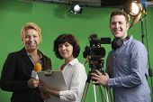 Постер, плакат: Portrait Of Cameraman With Presenter And Floor Manager In Televi