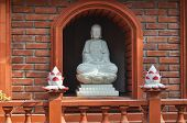 foto of trans  - figure of a buddha in Tran Quoc pagoda in Hanoi in Vietnam - JPG