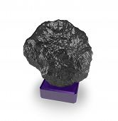 picture of meteor  - A large black stone on a stand is an abstract symbol of the mineral coal asteroid meteor and so on - JPG