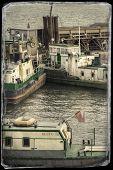 picture of shipyard  - Vintage postcard of ships moored at a shipyard - JPG