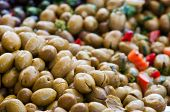 pic of pimiento  - Close up view of seasoned green olives in a weekly sicilian market - JPG