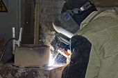foto of pipe-welding  - Welder produces a complex repair of the pipe element - JPG