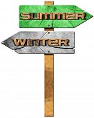 picture of directional  - Wooden directional sign with two arrows in opposite direction with text winter and summer isolated on white background - JPG