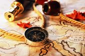 image of spyglass  - Marine still life with world map and spyglass on wooden table background - JPG