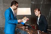 image of receptionist  - Hotel information available - JPG