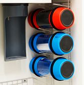 foto of transfer  - Pneumatic tube transfer system station and a row of capsules attached to a building wall - JPG