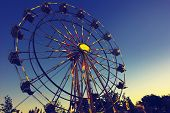 picture of carnival ride  - Carnival Ferris Wheel at sunset - JPG