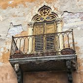 image of neglect  - Italian classic neglected balcony in Verona with peeled plaster rendering - JPG