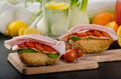 stock photo of smoked ham  - Wholemeal roll with smoked cheese cherry tomatoes and prague ham - JPG