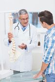 pic of spine  - Doctor explaining the spine to his patient in medical office - JPG