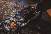picture of tramp  - nice guy and a girl together rest on the nature - JPG