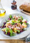 stock photo of rocket salad  - Prosciutto with rocket cantaloupe and radicchio salad - JPG