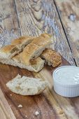 picture of flat-bread  - flat bread sticks with Tzatziki garlic dip on a rustic wooden table - JPG