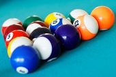 stock photo of pool ball  - Closeup of pool balls racked in triangle on a pool table - JPG