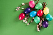 stock photo of willow  - Colored eggs and willow branches on a green background - JPG