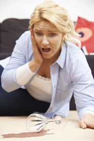 picture of horrifying  - Woman Accidentally Spilling Red Wine On Carpet At Home - JPG