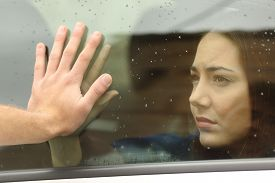 picture of say goodbye  - Couple saying goodbye before car travel holding hands through the window - JPG