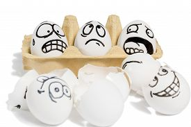 image of human egg  - Three eggs with frightened faces looking at a broken eggs lying near isolated on white background - JPG