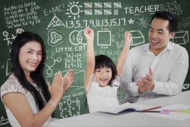 image of applause  - Portrait of happy little girl raise hands after finish her homework and get applause - JPG